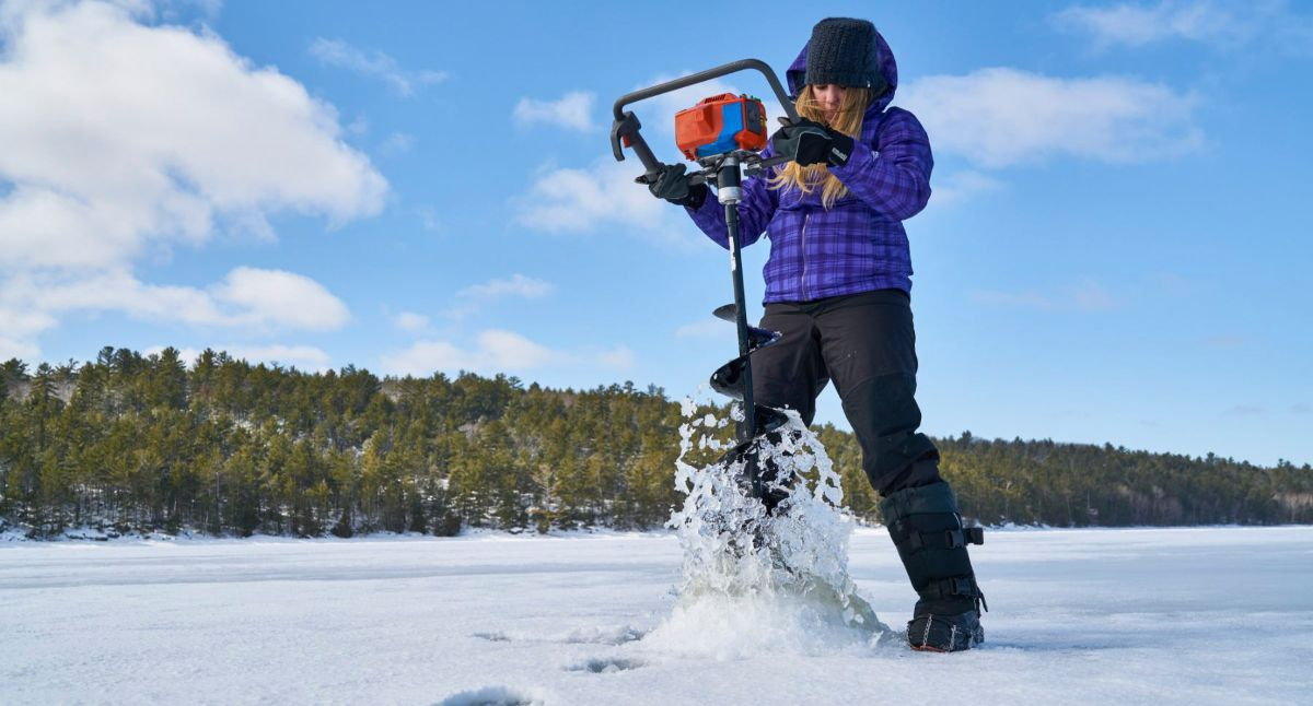 Ice Fishing Northeastern Ontario - Woman with Ice Auger